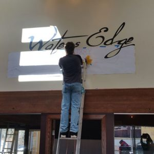 how to install a lobby sign