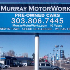 Cabinet pole signs for auto dealers on Broadway in Denver