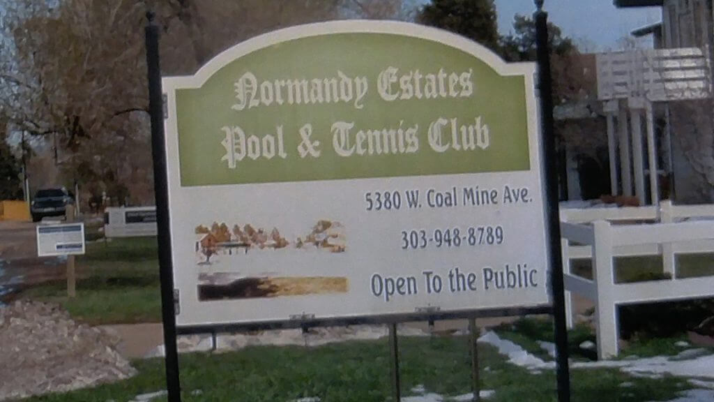 Old sign at Normandy Pool and Tennis Club