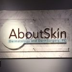 Lobby Sign for About Skin in Englewood, CO