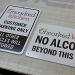 Aluminum sign for Uncorked Kitchen in Denver, CO