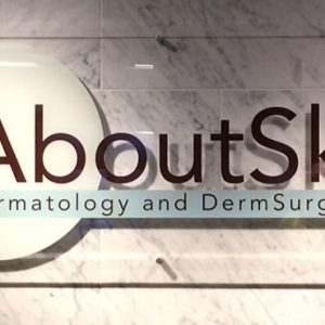 Custom Cut Vinyl on Acrylic Lobby Sign for About Skin in Englewood, CO
