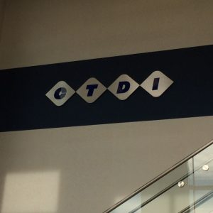 Custom Routed Aluminum and Acrylic Lobby Sign for CTDI in Englewood