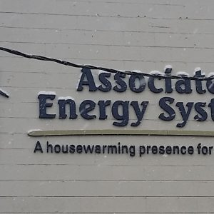 Custom Sign Foam Letters mounted on the exterior of Associated Energy Systems in Denver, CO