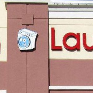 Channel Letters mounted on the exterior of Coin Laundry in Denver, CO