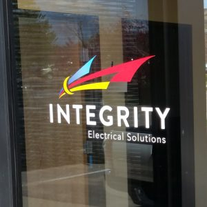 Custom Cut Vinyl Logo and Lettering on the front window of Integrity Electric in Golden, CO