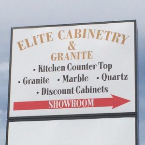 Light Cabinet Sign mounted onto pole for Elite Cabinetry in Denver, CO
