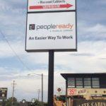 Light Cabinet Sign mounted onto pole for Elite Cabinetry in Denver, CO