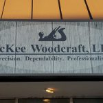Light Cabinet Sign installed above Mckee Woodcraft in Englewood, CO