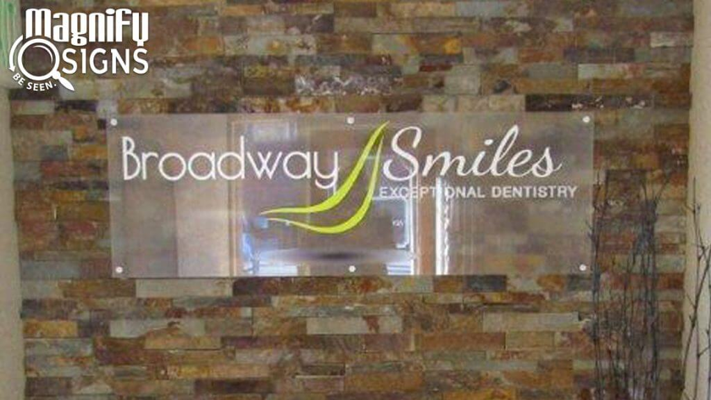 Custom Acrylic Panel Sign for Broadway Smiles entrance in Denver, CO