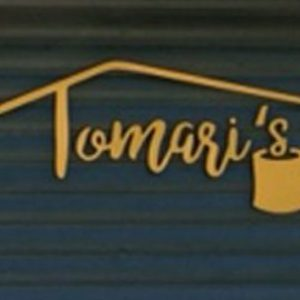 Custom Sign Foam Letters installed on the exterior of Tomaris in Denver