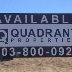 Wooden Post and Panel Sign with Graphic Print on the face for Quadrant Properties in Denver, CO