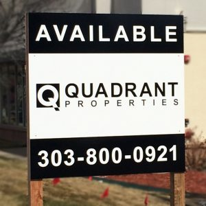 Wooden Post and Panel Sign with Graphic Print on the face for Quadrant Properties in Englewood, CO
