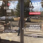 Custom Window Vinyl on the front glass doors of Resilience Code in Denver, CO