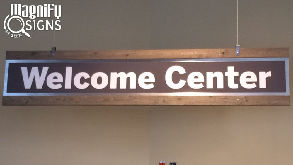 Foyer Sign with an Aluminum Panel inbetween Wooden Clamps for The Rock Church in Littleton, CO