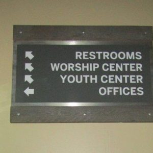 Interior Wayfinding sign with an Aluminum Panel between two Wooden Clamps for The Rock Church in Littleton, CO