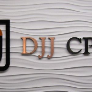 Custom Acrylic Lobby Sign with Brushed Copper Face in for the office of DJJCPA in Denver, CO