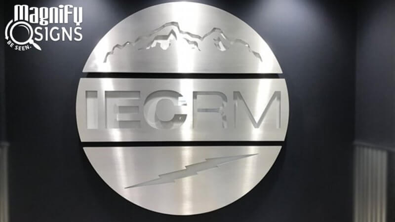 Aluminum custom routed Lobby Sign for IEC-RM in Northglenn, CO
