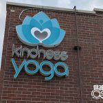 kindness yoga building signs